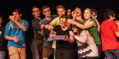 The members of the improv group DTR performing during their CHAOS show last spring. (Photo: Dani Holloway)