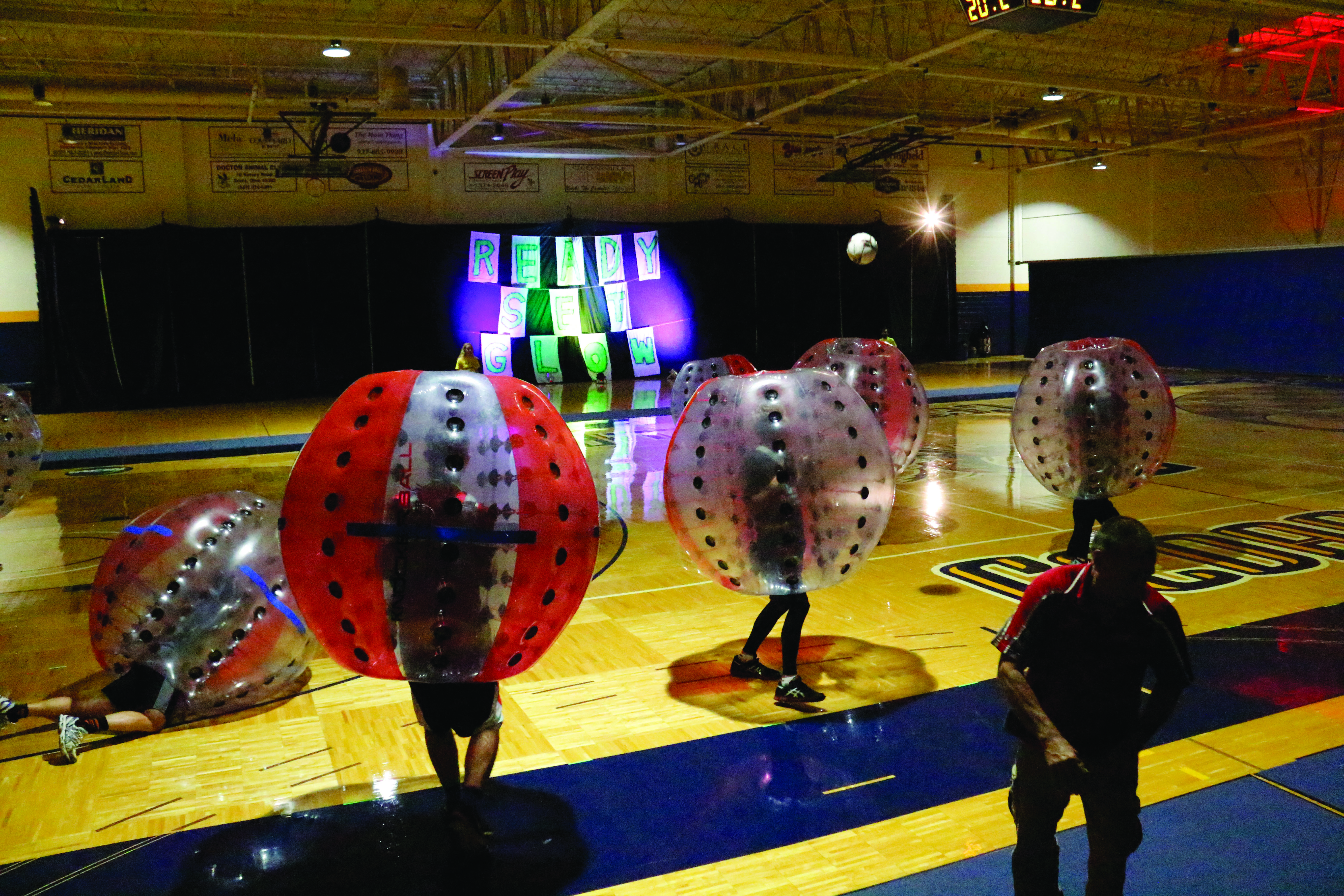 Students engage in a glowing competition.