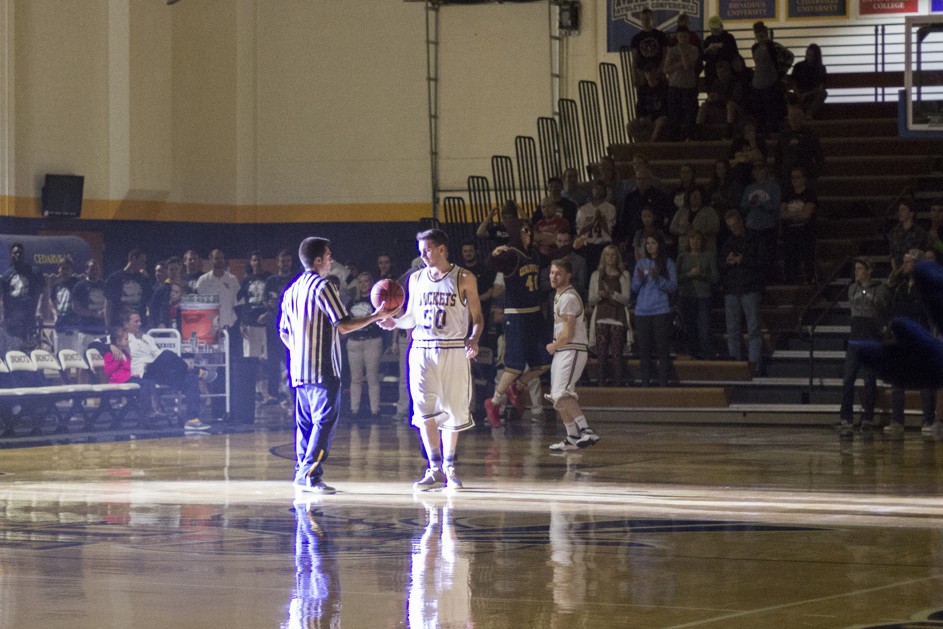 Junior Vincenzo Morrone kicks off the night with a skit on how not to play basketball. Morrone led the crowd in scolding the four players involved when each of them broke a rule of basketball.