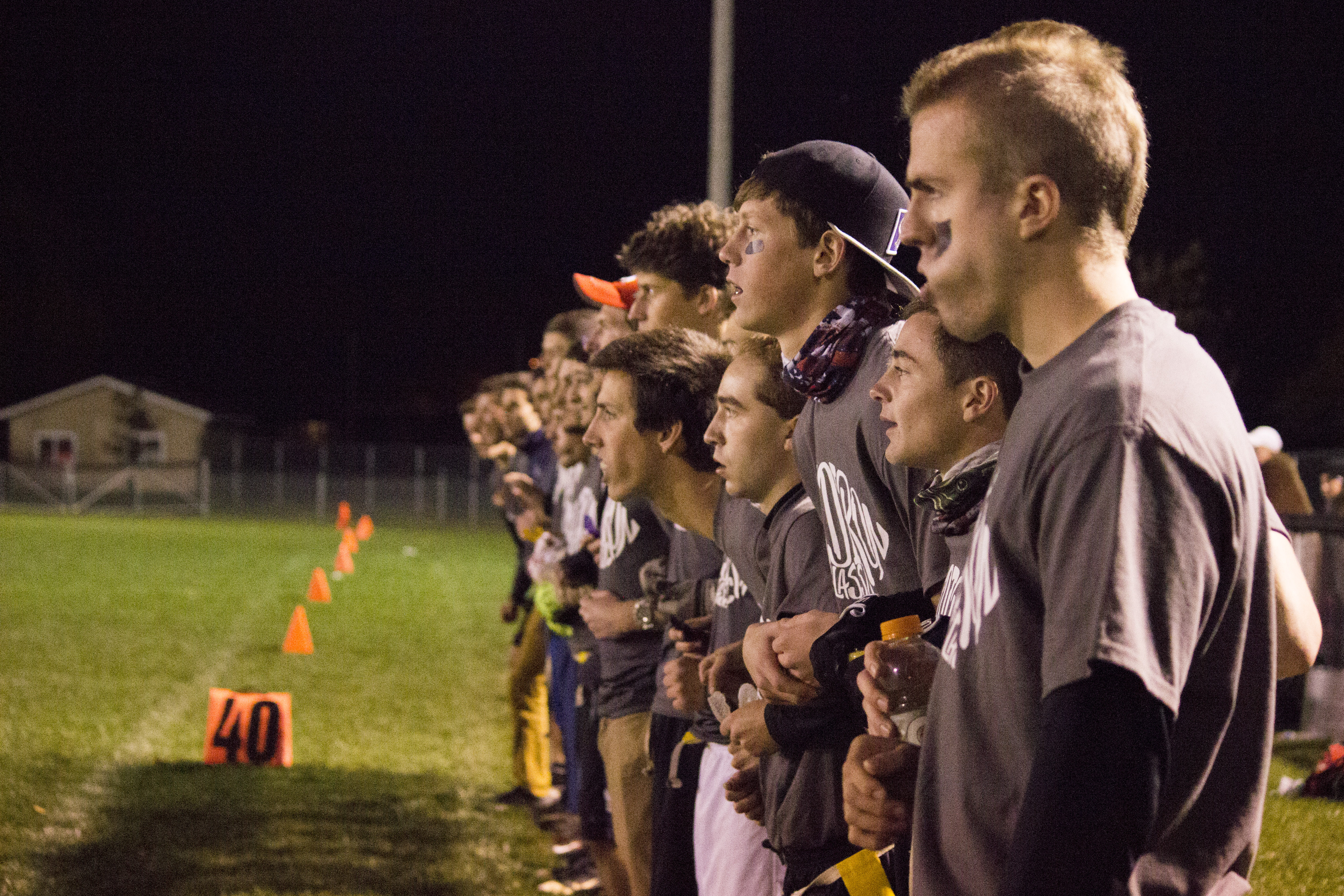"""The Hill watches intently as their teammate attempts to break the tied score with a risky field goal kick. The kick is """"no good"""", sending the game into overtime."""