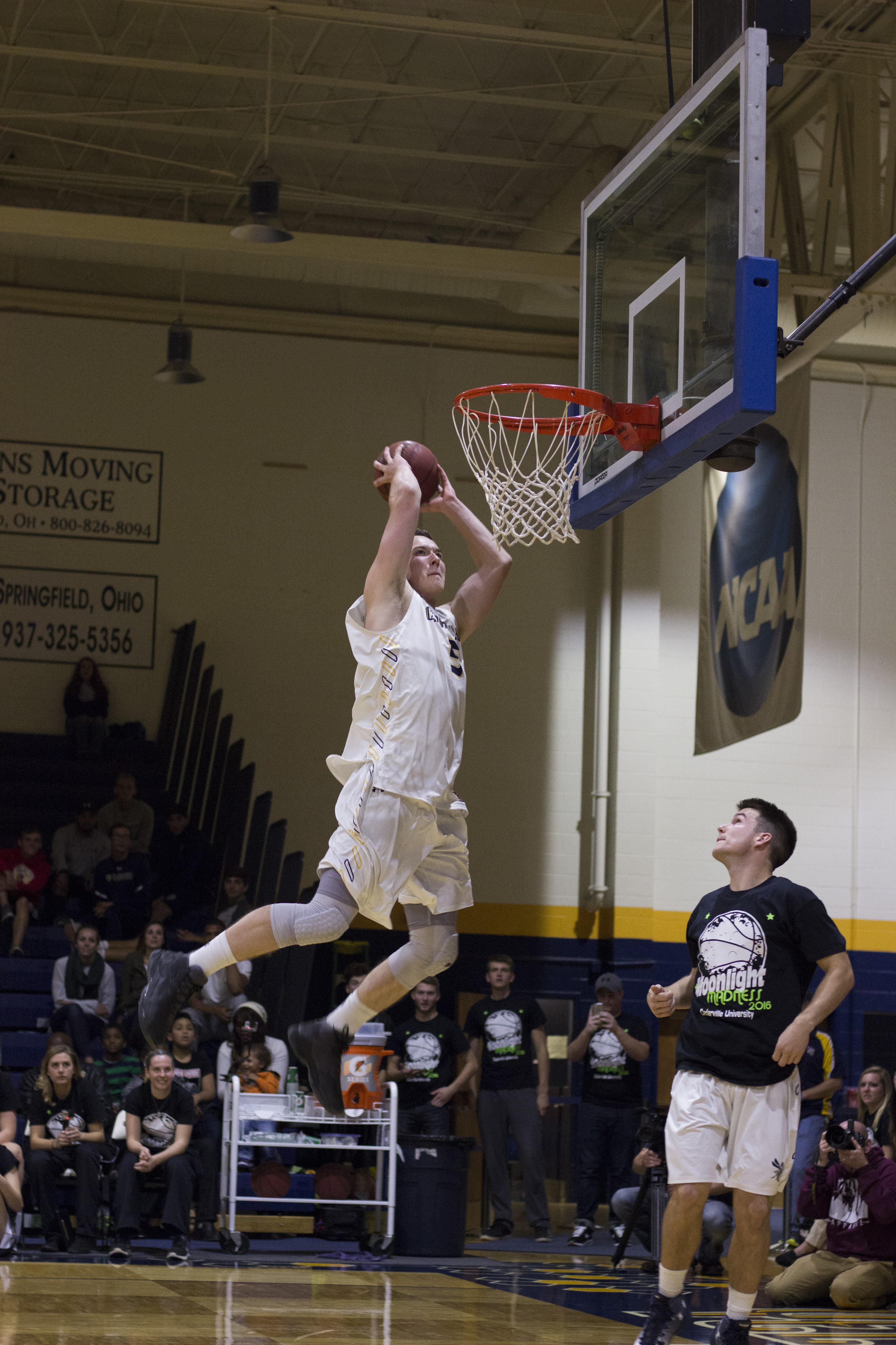 Senior Easton Bazzoli gives it his all during the dunking challenge, the night's closing event.
