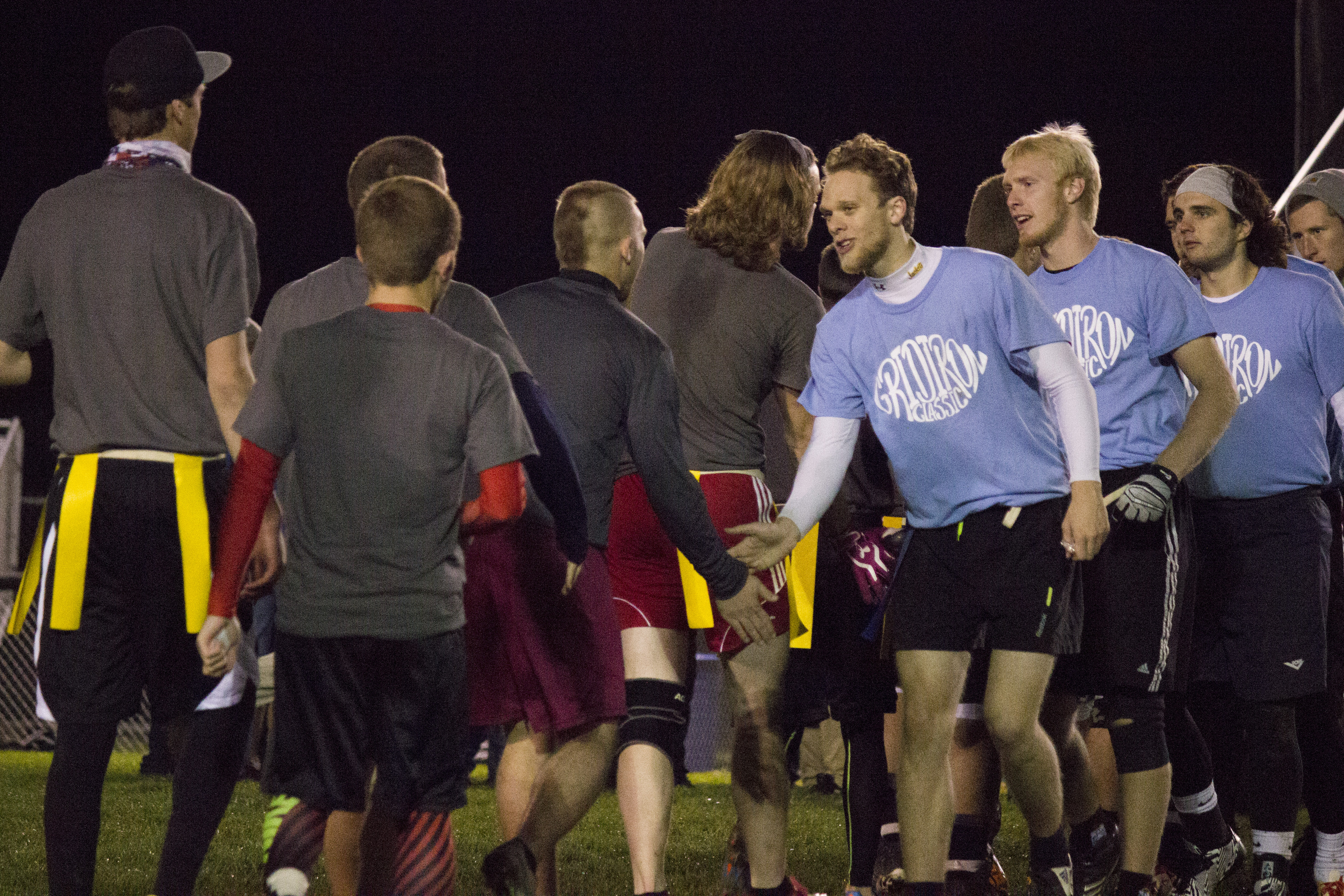 """Teams shake each other's hands, congratulating each other on a """"good game""""."""