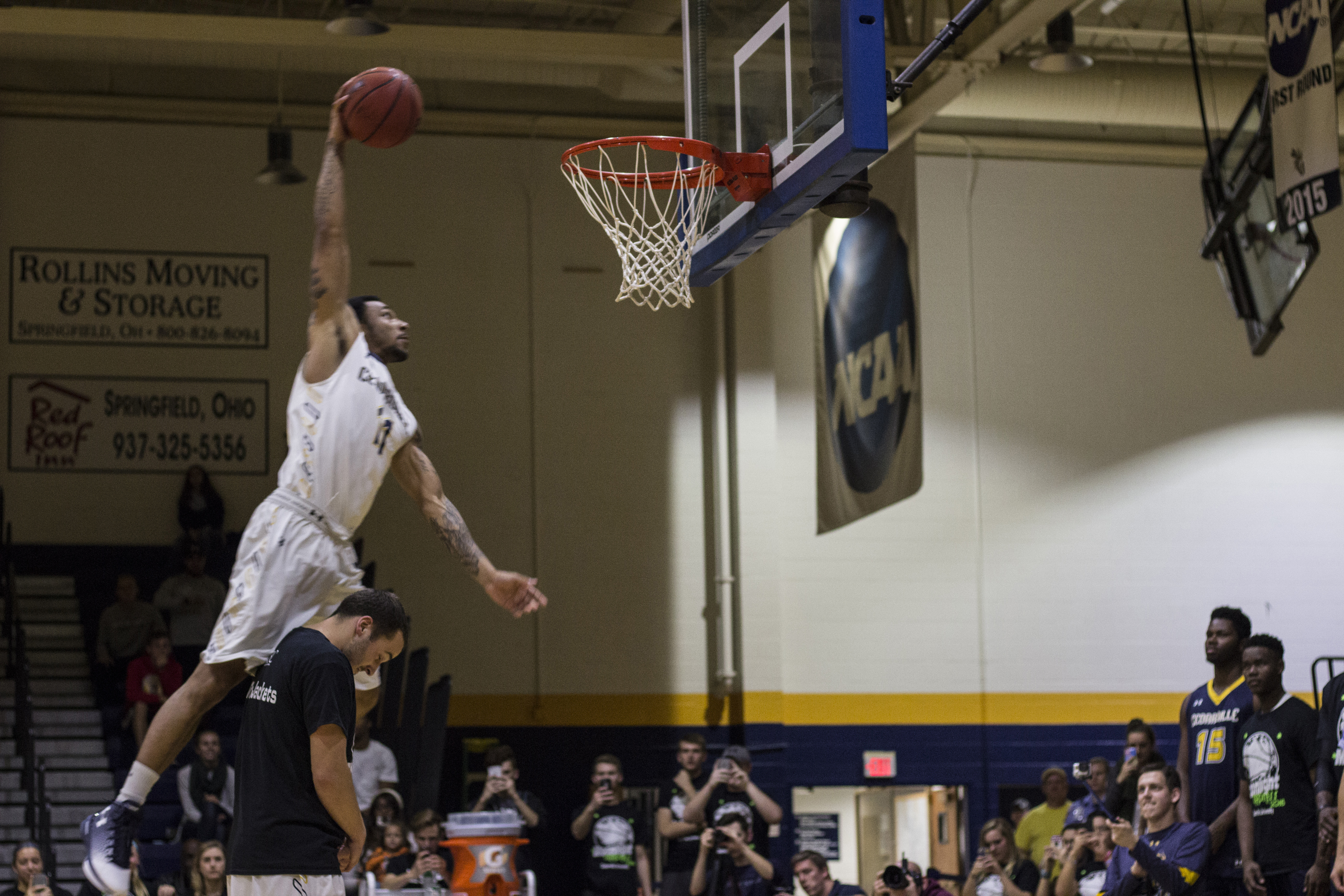 Junior Dazhonetae (Tae) Bennett performs the final dunk, an impressive slam dunk while jumping over a partner, bringing the night to a close.