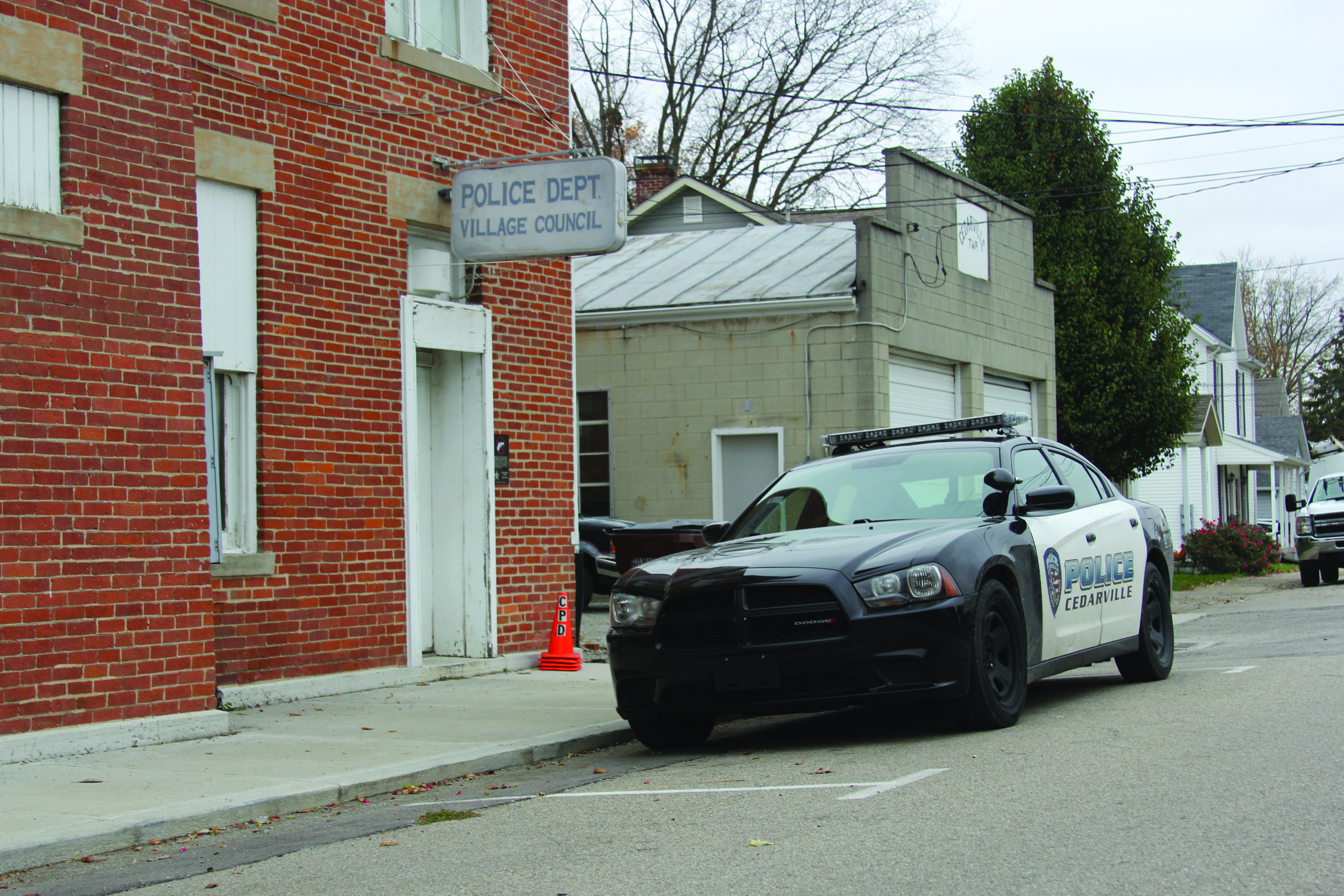 The police department shares space with the Village Council in the Opera House building. The only available space for parking the police cruisers is on the side of the street. [Photo by Keegan D'Alfonso]