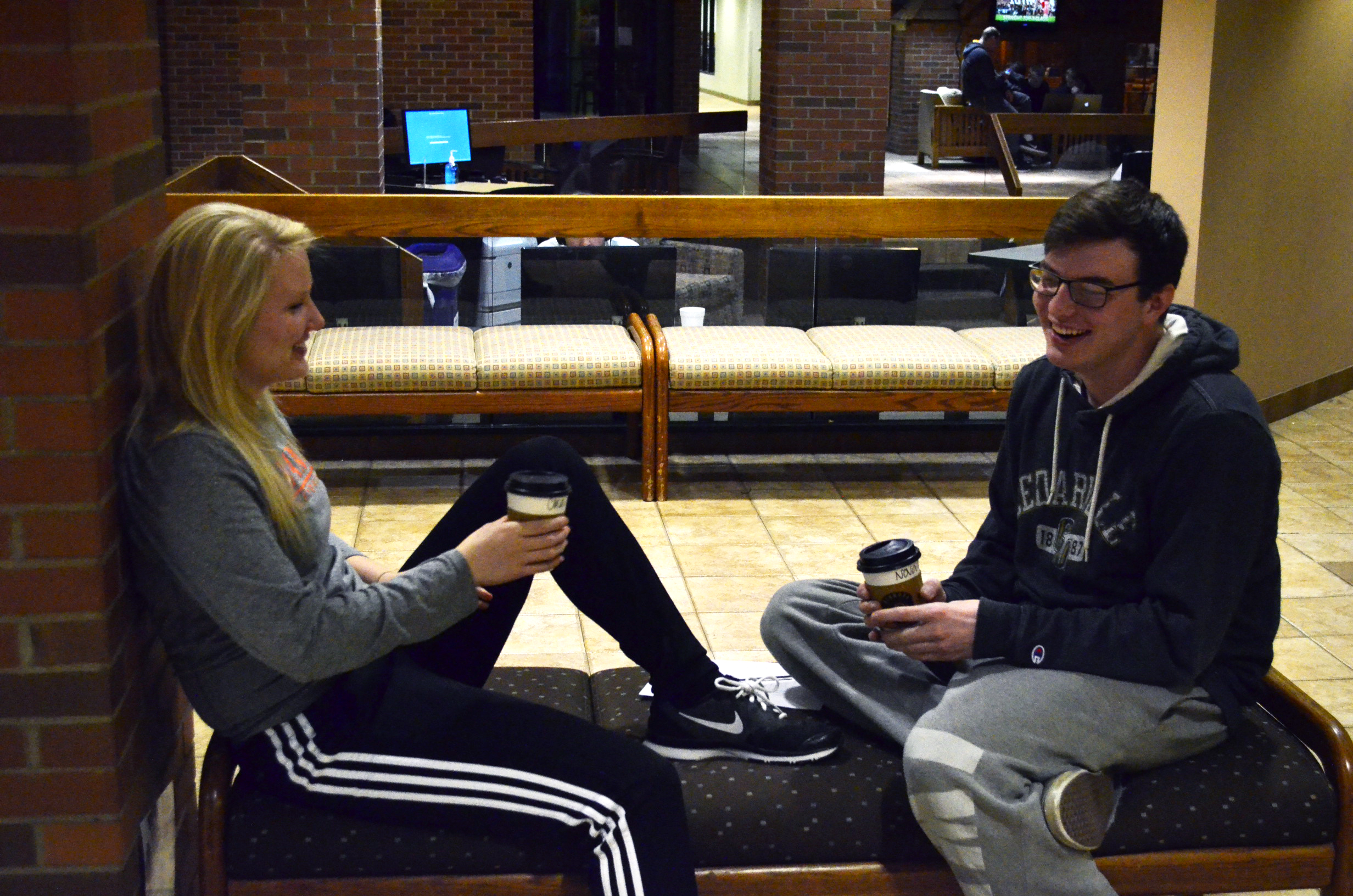 """""""Find a place to sit, relax, and enjoy the conversation. It is really fun if you put some effort into it. Make sure your phone is off or put away though [smiles]."""" (Freshmen Kimmy Powell and Noah Augustus enjoy quality time at the most recent Coffee & Community. [Photo courtesy of Allyson Weislogel])"""