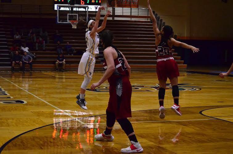 Regina Hochstetler takes a 3-point shot (Photo: Allyson Weislogel).